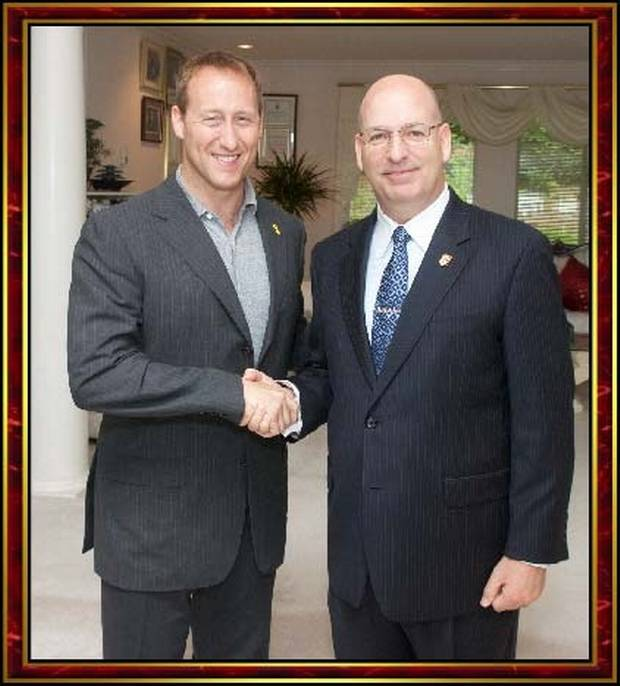 Mr. Goodwin shakes hands with Peter MacKay, then the federal defence minister, in Surrey, B.C., on July 15, 2012.