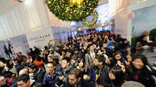 Shoppers rush through the doors as Macy's opens for Black Friday. (Peter Foley/Bloomberg)