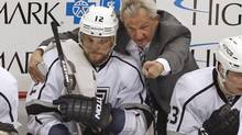 Darryl Sutter does not like to play matchups, preferring to roll four lines every game. (Gene J. Puskar/The Associated Press)