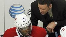 Montreal Canadiens head coach Randy Cunneyworth talks with defenseman P.K. Subban after the Chicago Blackhawks scored a goal in the third period of their NHL hockey game in Chicago, December 21, 2011. Subban said on Monday he was embarrassed by Cunneyworth's move to scratch him from Friday's game in Boston. REUTERS/Frank Polich (Frank Polich/Reuters)
