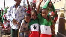 The people of the self-proclaimed nation of Somaliland draped themselves in every variation of their national flag as they attended their Independence Day parade on May 18 in their capital, Hargeisa. (Geoff York/The Globe and Mail)