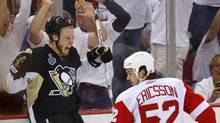 Pittsburgh Penguins Jordan Staal celebrates after his goal on Detroit Red Wings goalie Chris Osgood as Red Wings defenceman Jonathan Ericsson looks on during the second period of Game 6 of the Stanley Cup final. (SHAUN BEST)