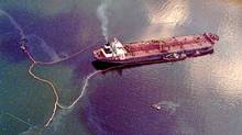 The oil tanker Exxon Valdez, which spilled more than 10 million gallons of oil into Alaska waters, awaits temporary repairs to holes ripped in its hull in this 1989 photo. The tanker's captain, Joseph Hazelwood, was found to have been impaired when he hit a reef. (John Gaps/AP)