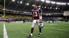 Montreal Alouettes quarterback Anthony Calvillo walks off the field following their loss to the Hamilton Tiger-Cats during CFL East Division semifinal action Sunday, November 13, 2011 in Montreal. (Tom Boland/THE CANADIAN PRESS)