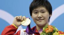 China's Ye Shiwen poses with her gold medal for the women's 400-metre individual medley swimming final at the Aquatics Centre in the Olympic Park during the 2012 Summer Olympics in London, Saturday, July 28, 2012. (Michael Sohn/AP)