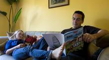 Stephanie Morgenstern and Mark Ellis, actors and co-writers on the TV show Flashpoint, read together in their Oakville, Ont., home on June 29, 2010. (Sarah Dea for The Globe and Mail)
