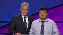 Arthur Chu on Jeopardy! with host Alex Trebek. (YouTube)