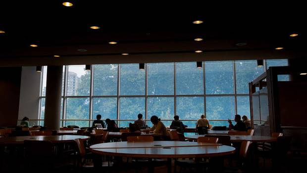 Students are silhouetted in the Irving K. Barber Learning Centre on the University of British Columbia campus in Vancouver, B.C., on Thursday August 20, 2015.