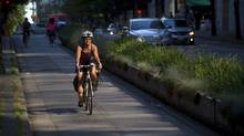 Commuters ride bicycles on the Hornby Street bike lane in downtown Vancouver, British Columbia on July 2, 2013. (BEN NELMS for The Globe and Mail) (Ben Nelms/The Globe and Mail)