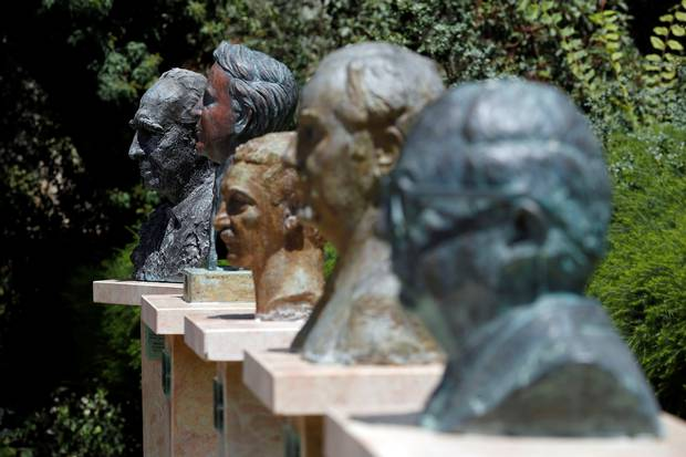 A bust of Mr. Peres, left, is seen next to other former Israeli presidents in the gardens at the Israeli presidential residence in Jerusalem.