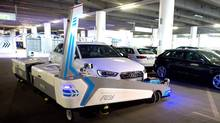 "Parking robot ""Ray"" transports a car in Duesseldorf, Germany, Monday, 23 June 2014. The parking robot will see service for the first time at Duesseldorf Airport. (Federico Gambarini/AP Photo/dpa)"