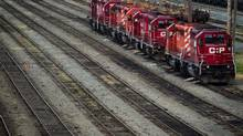 Canadian Pacific Rail locomotives sit idle at the company's Port Coquitlam yard east of Vancouver on May 23, 2012. CP announced from Minneapolis on Tuesday morning that it is exploring strategic options for a line that runs from Tracy in Minnesota west into South Dakota, Nebraska and Wyoming. (DARRYL DYCK/THE CANADIAN PRESS)