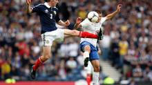 Scotland's Paul Dixon, left, vies for the ball with Serbia's Aleksandar Ignjovski during their World Cup qualifying Group A soccer match at Hampden Park, Glasgow, Scotland, Saturday Sept. 8, 2012. (SCOTT HEPPELL/AP)