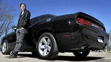 Mark Spicoluk with his 2010 Dodge Challenger R/T. (Fred Lum/The Globe and Mail/Fred Lum/The Globe and Mail)