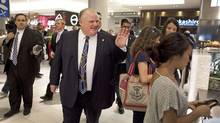 Toronto Mayor Rob Ford walks through the food court at the Eaton Centre mall on June 5, 2012, on its first day back in business after a gunman fired shots there, killing one man. (Moe Doiron/The Globe and Mail)