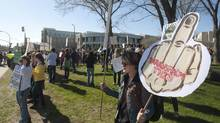 Members of a student-led TransformThis organization gather before a rally againstof the University of Saskatchewan administration on campus in Saskatoon, Tuesday, May 20, 2014. (Liam Richards/THE CANADIAN PRESS)