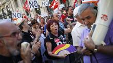 Civil servants shout slogans as they take part in a protest in Madrid against government austerity measures on Aug. 24, 2012. (JUAN MEDINA/REUTERS)