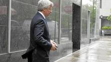 JPMorgan Chase CEO Jamie Dimon leaves after speaking at a Deutsche Bank Securities conference on Monday, May 21, 2012 in New York. (Jin Lee/AP)