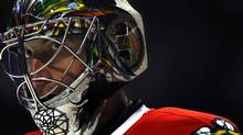 Chicago Blackhawk goalie Cristobal Huet, from France, looks on during the first period of a preseason NHL hockey game against the Minnesota Wild in Chicago on Friday, Sept. 25, 2009. (Charles Cherney/The Associated Press)