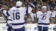 Tampa Bay Lightning's Teddy Purcell and Steven Stamkos celebrate after a goal by Stamkos in the first period of an NHL hockey game against the Philadelphia Flyers, Monday, March 26, 2012, in Philadelphia. (Matt Slocum/Associated Press)