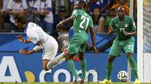Ivory Coast's Giovanni Sio commits a foul on Greece's Georgios Samaras during their 2014 World Cup Group C soccer match at the Castelao arena in Fortaleza June 24, 2014. Greece was awarded a penalty kick which they scored to win the match. (Reuters)