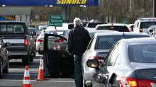 Cars wait in long lines at a Sunoco gas station on the Garden State Parkway in Montvale, N.J. (MIKE SEGAR/REUTERS)