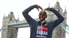 "Britain's double Olympic champion Mo Farah makes his trademark ""Mobot"" pose for photographers during a media event for the London Marathon, at Tower Bridge in London April 18, 2013. Farah will run half the course on Sunday before tackling the full marathon in 2014. (SUZANNE PLUNKETT/REUTERS)"