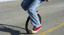 unicycle balance/ closeup (Mary Gascho/Getty Images/iStockphoto)