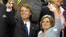 Then Democratic vice presidential candidate John Edwards and his wife Elizabeth wave to delegates on the final night of the Democratic National Convention in 2004. (PAUL J. RICHARDS/PAUL J. RICHARDS/AFP/Getty Images)