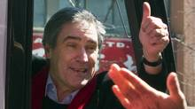 Liberal Leader Michael Ignatieff gives a thumbs up to supporters after campaigning in the Chinatown area of Toronto. (Ryan Remiorz/The Canadian Press)