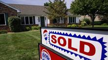 A sold sign is posted outside a home in Springfield, Ill., that's been sold. (Seth Perlman/Seth Perlman/AP)