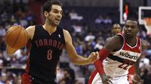 Toronto Raptors' Jose Calderon controls the ball as Washington Wizards' Shelvin Mack during the first half of their NBA game in Washington. (LARRY DOWNING/Reuters)