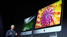 Tim Cook describes new models of the iMac desktop computers at the Apple event. (ROBERT GALBRAITH/REUTERS)