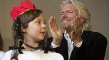 Sir Richard Branson claps during a press conference in Vancouver after children from Project Limelight sang for Branson and Canadian actor Cory Monteith in Vancouver May 25, 2012. (John Lehmann/The Globe and Mail/John Lehmann/The Globe and Mail)