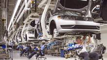FILE - In this July 12, 2013, photo, employees at the Volkswagen plant in Chattanooga, Tenn., work on the assembly of a Passat sedan. Volkswagen on Monday, July 14, 2014 said it will build a new seven-passenger SUV at the Chattanooga factory, adding about 2,000 jobs. (AP Photo/Erik Schelzig, File) (Erik Schelzig/AP)