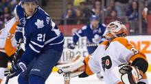 Philadelphia Flyers goaltender Cal Heeter keeps an eye on the puck as he makes a save on Toronto Maple Leafs James van Riemsdyk in second period NHL preseason action in Toronto on Monday September 16, 2013. (Frank Gunn/THE CANADIAN PRESS)
