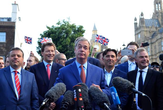 Nigel Farage, middle, leader of the United Kingdom Independence Party, speaks during a press conference near the Houses of Parliament in central London on June 24, 2016.