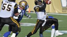 The Hamilton Tiger-Cats and quarterback Henry Burris face the Montreal Alouettes in Sunday's CFL Eastern semi-final. (Fred Greenslade/THE CANADIAN PRESS)