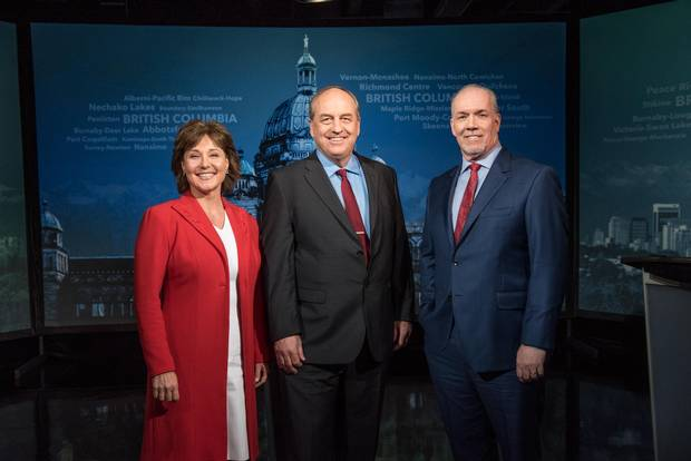 Weaver, centre, is flanked by BC Liberal Leader Christy Clark and B.C. NDP leader John Horgan at an election campaign debate on April 26, 2017.