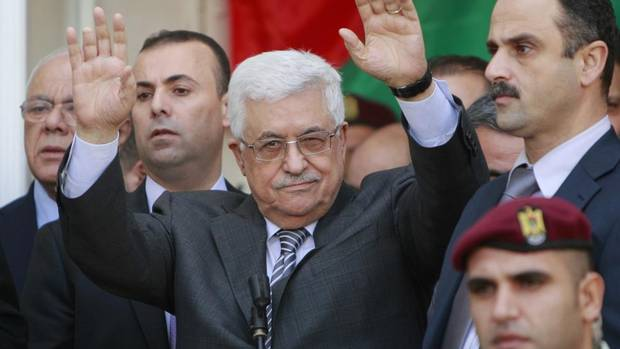 Palestinian President Mahmoud Abbas waves to the crowd during a rally supporting the Palestinian UN bid for observer state status, in the West Bank city of Ramallah, Sunday, Nov. 25, 2012. The Palestinians will request to upgrade their status on November 29. The status could add weight to Palestinian claims for a state in the West Bank, Gaza Strip and east Jerusalem, territories captured by Israel in the 1967 Mideast war from Jordan. (Majdi Mohammed /AP)