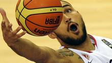 Canadia's Robert Sacre grabs the ball in front of Lebanese Matt Freije (R) during their preliminary round match of the Group D between Canada and Lebanon at the FIBA World Basketball Championships in Izmir, on August 28, 2010. Getty Images / FRANCK FIFE (FRANCK FIFE)