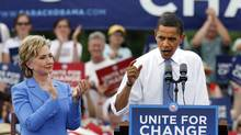 Barack Obama speaks as Hillary Rodham Clinton applauds at a campaign event in Unity, N.H. Friday, June 27, 2008, during their first joint public appearance since the divisive Democratic primary race ended. (Elise Amendola/Associated Press/Elise Amendola/Associated Press)