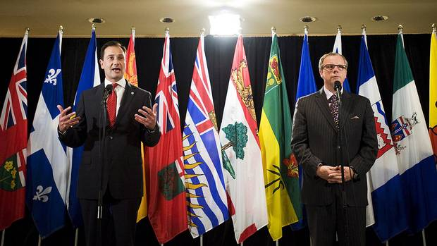 P.E.I. Premier Robert Ghiz, left and Saskatchewan Premier Brad Wall speak at a press conference to discuss health care innovation in Canada in Toronto on Friday, June 1, 2012.