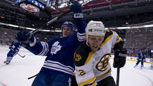 Toronto Maple Leafs defenceman Jake Gardiner and Bruins Shawn Thornton battle for the puck in the corner during the first period of Game 4 between the Toronto Maple Leafs and the Boston Bruins at the Air Canada Centre in Toronto on May 08, 2013 (Peter Power/The Globe and Mail)