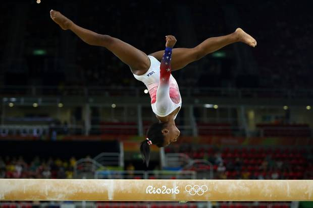 Aug. 17, 2016: Simone Biles of the United States performs on the beam on Day 12 of the 2016 Rio Olympic Games.