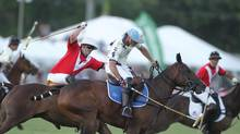 Fred Mannix challenges Adolfo Cambiaso the highest ranked player on the World Polo Tour during the American Triple Crown, USPA Piaget Gold Cup, March 18, 2012. (David Lominska)
