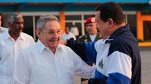 Venezuelan President Hugo Chavez (R) shakes hands with his Cuban counterpart Raul Castro upon his return to Venezuela, in Havana May 11, 2012. (Handout/REUTERS)