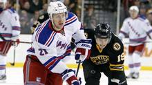 New York Rangers' Derek Stepan (21) brings the puck up in front of Boston Bruins' Tyler Seguin (19) during the first period of an NHL hockey game in Boston, Saturday, Jan. 21, 2012. (Michael Dwyer/AP)
