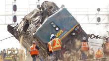 Crews right a locomotive in Burlington where a VIA rail train derailed Feb. 26, 2012, killing three. (Peter Power/The Globe and Mail)