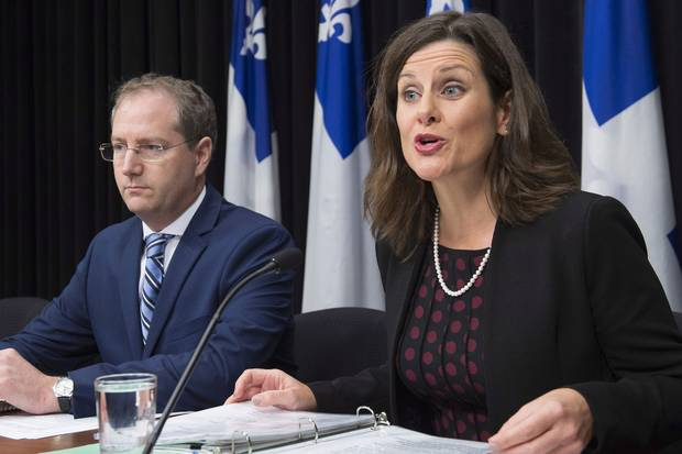 Oct. 24, 2017: Quebec Justice Minister Stephanie Vallée, right, provides further details about how the government's controversial Bill 62 at a Quebec City news conference.